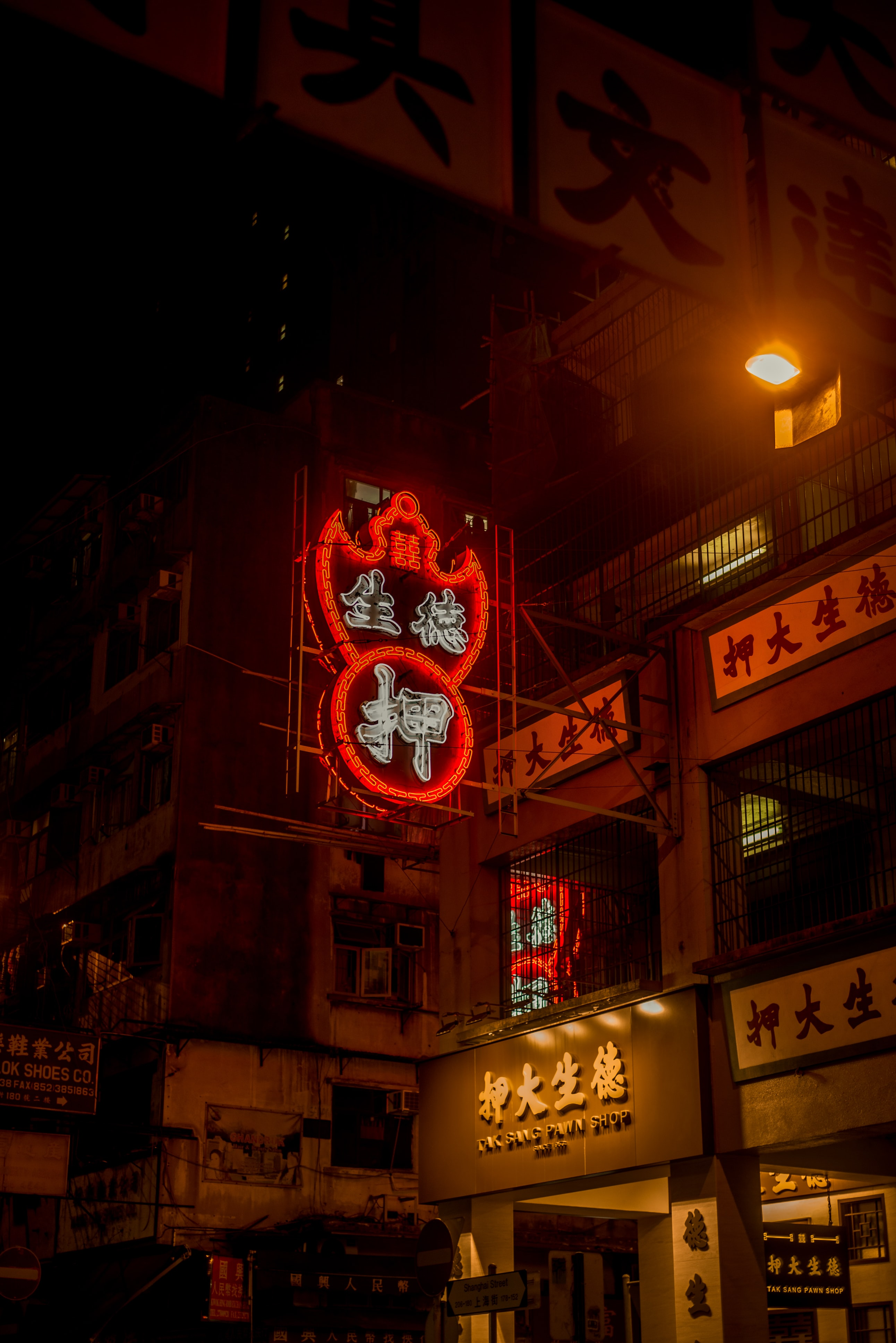 low-angle photography of red and white lighted signage