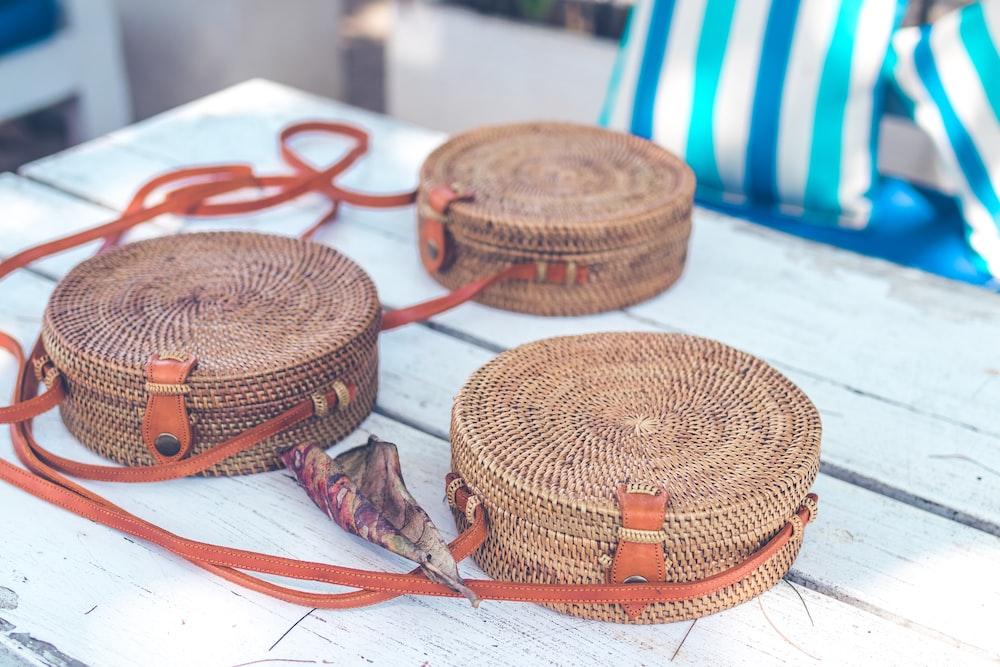three brown wicker baskets