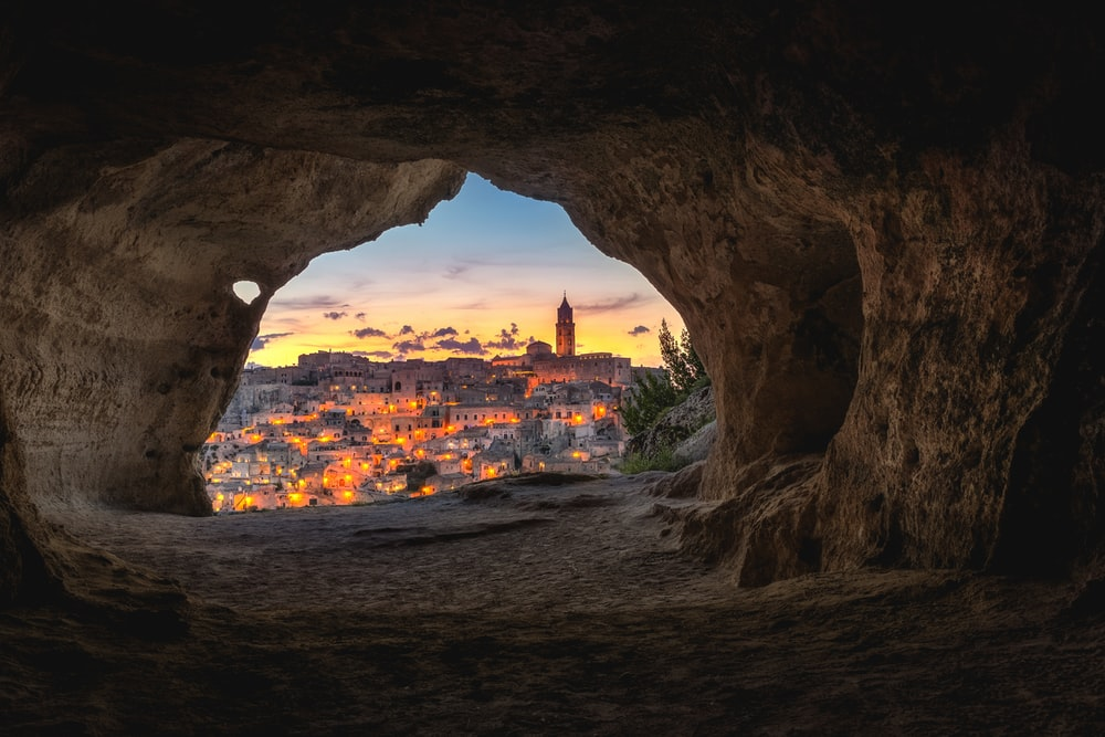 brown cave with over-view of city