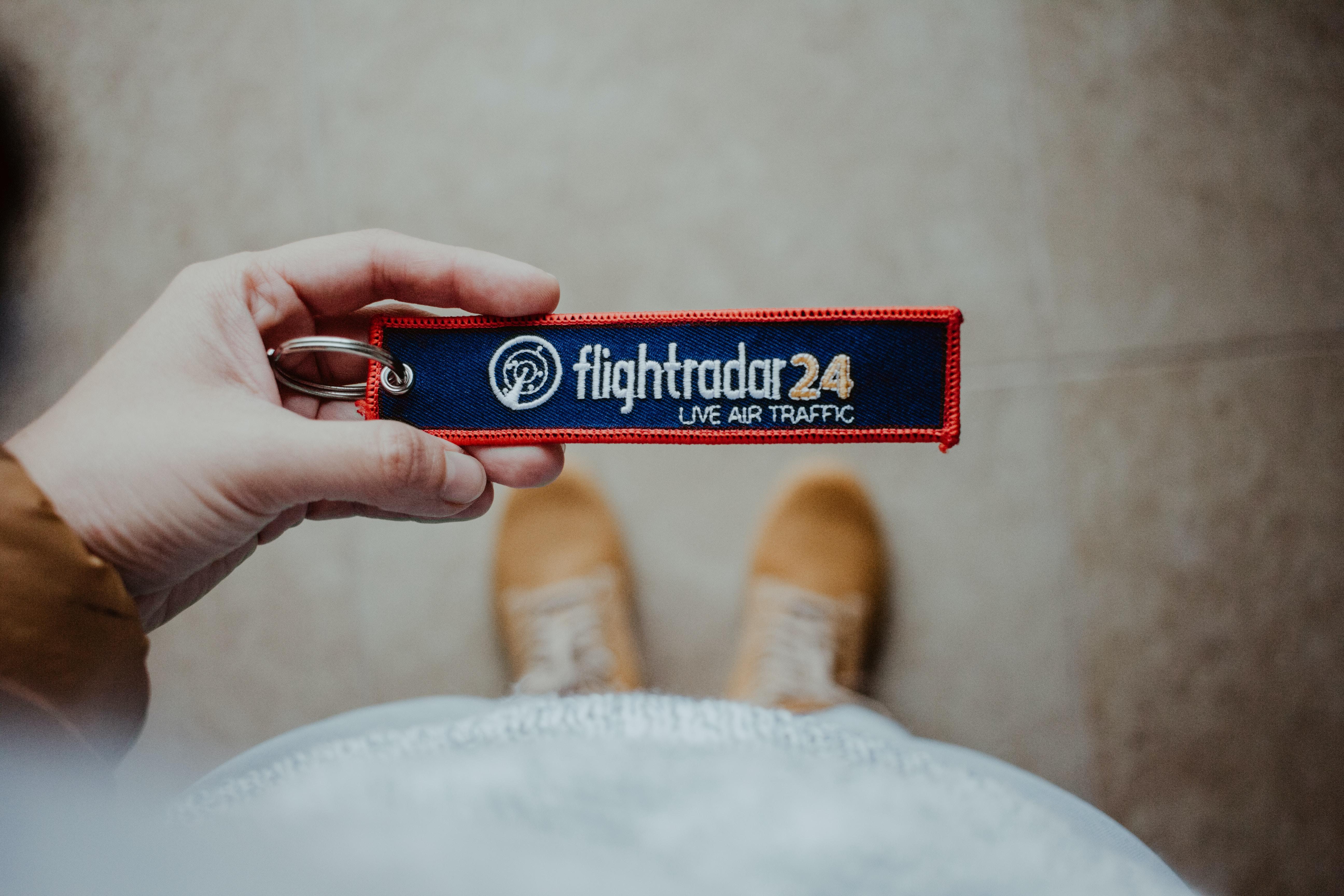 person holding Flightradar 24 card