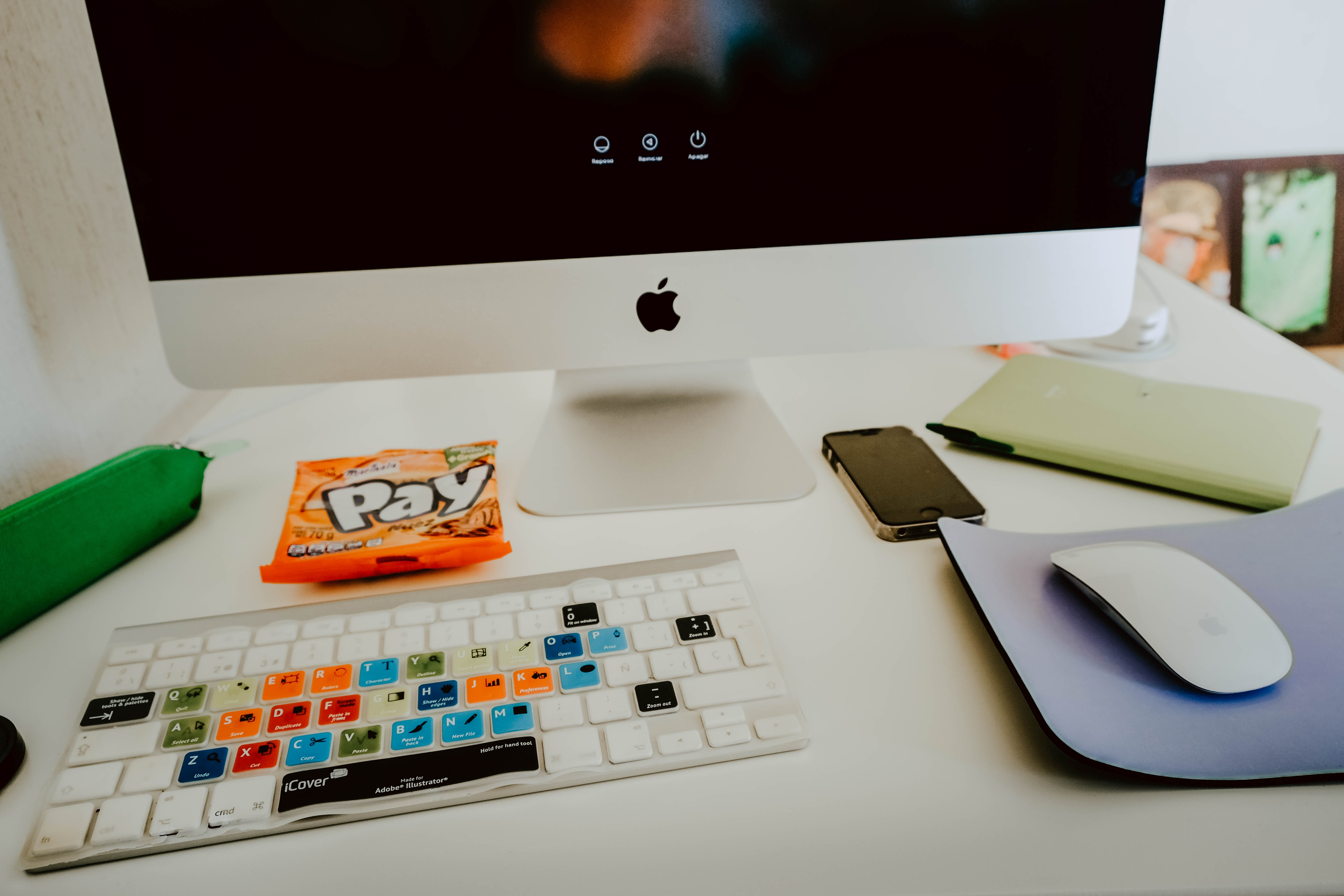 turned on silver iMac, Apple Magic Mouse, and Apple Magic Keyboard on desk
