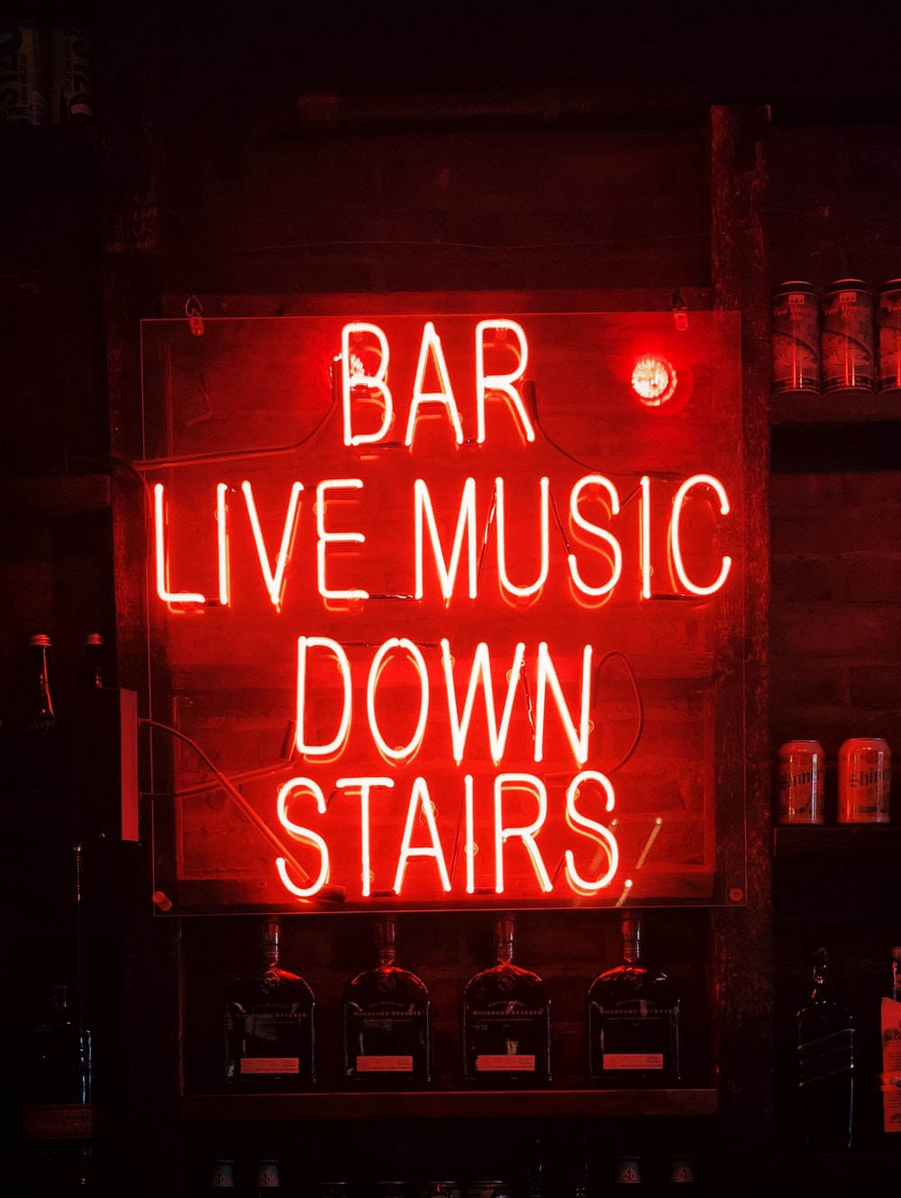 bar live music down stairs neon light signage