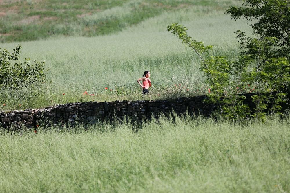woman running through grass