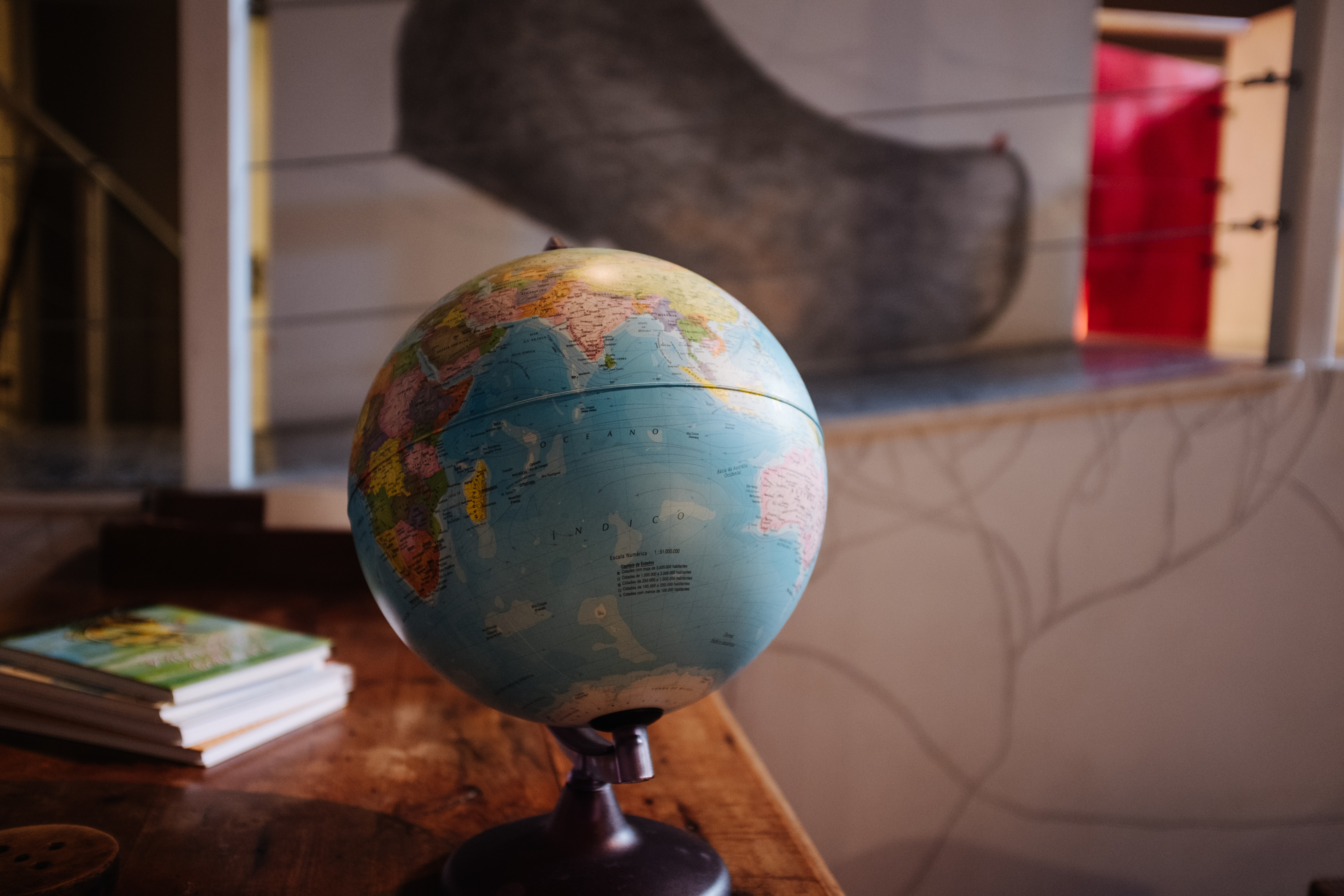 selective focus photography of desk globe on table