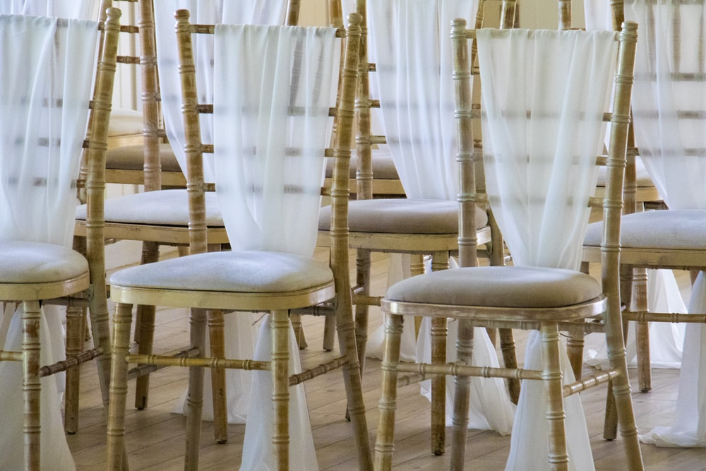 person showing brown bamboo-themed chairs