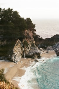body of water beside rock formations