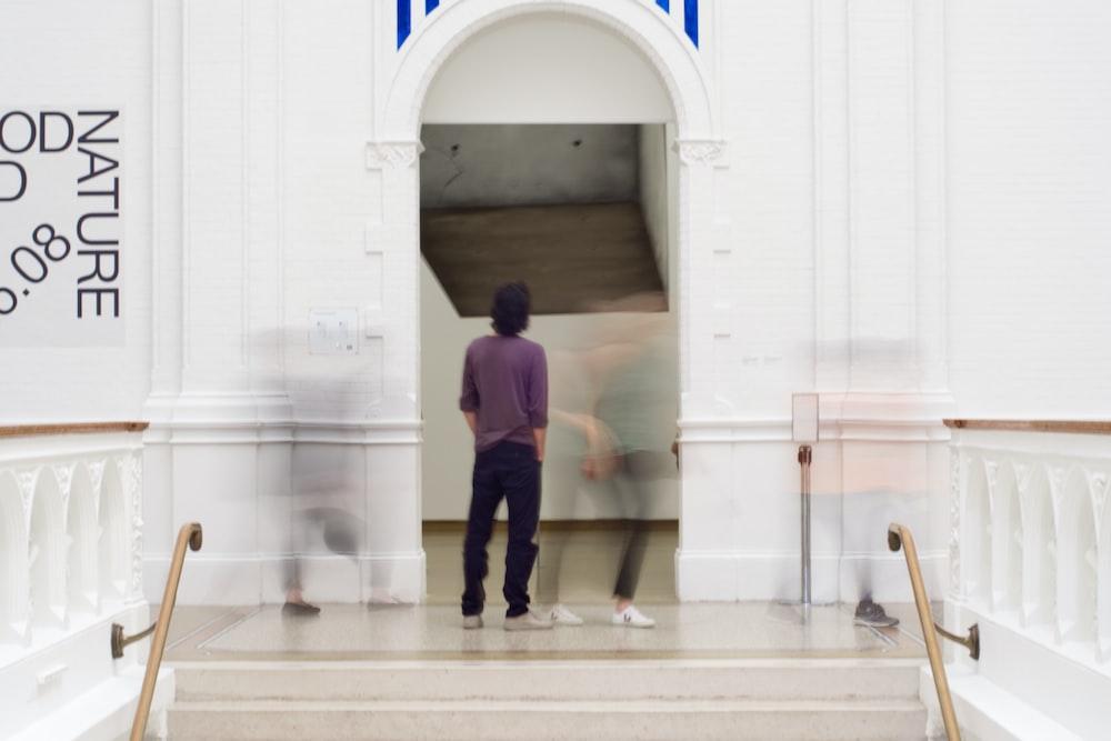 man standing on door