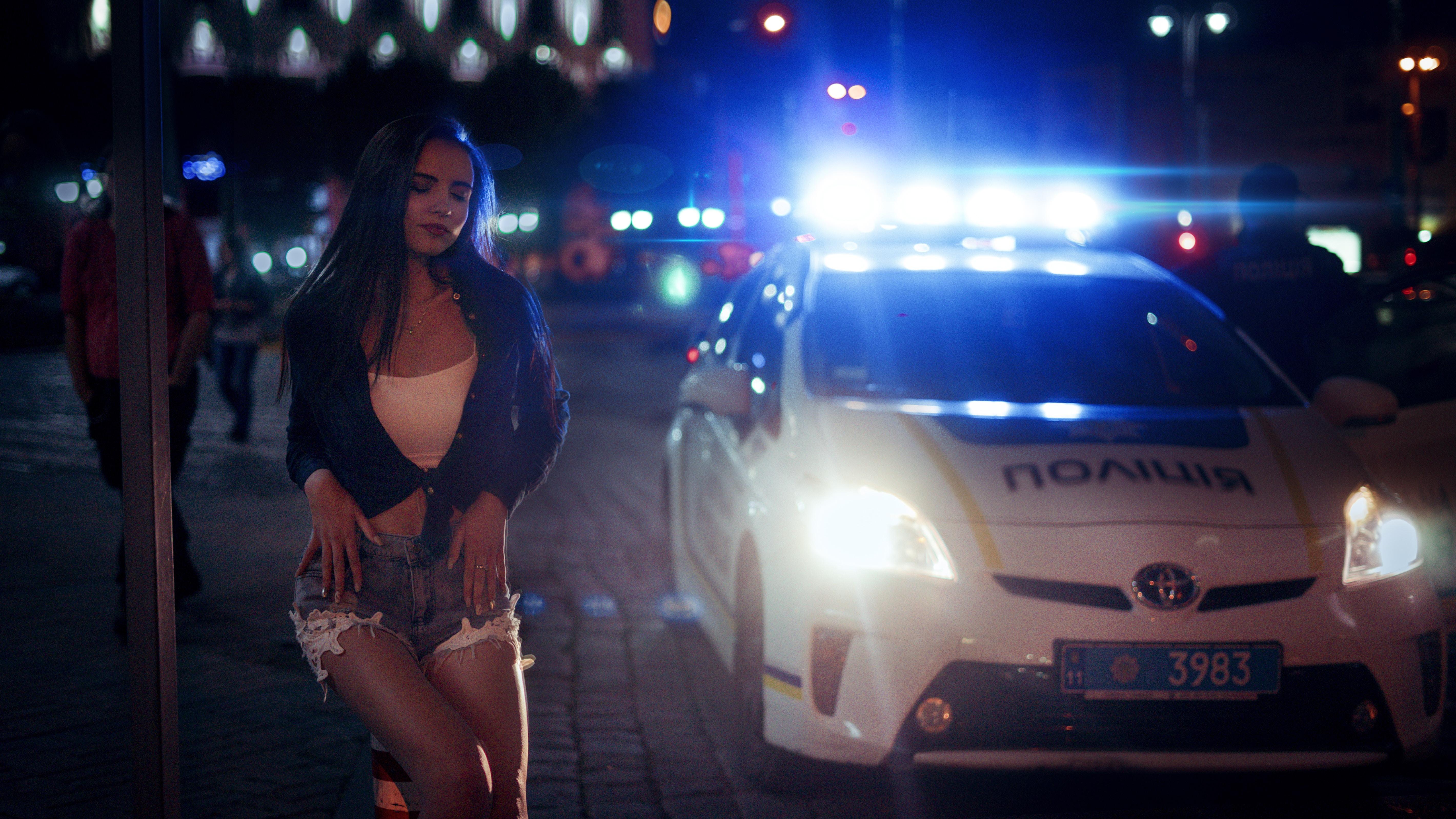 woman beside white Toyota car