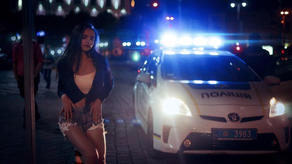 god punishes woman beside white Toyota car