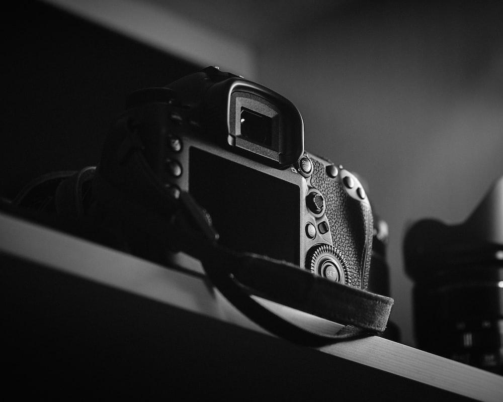 DSLR camera on top of shelf