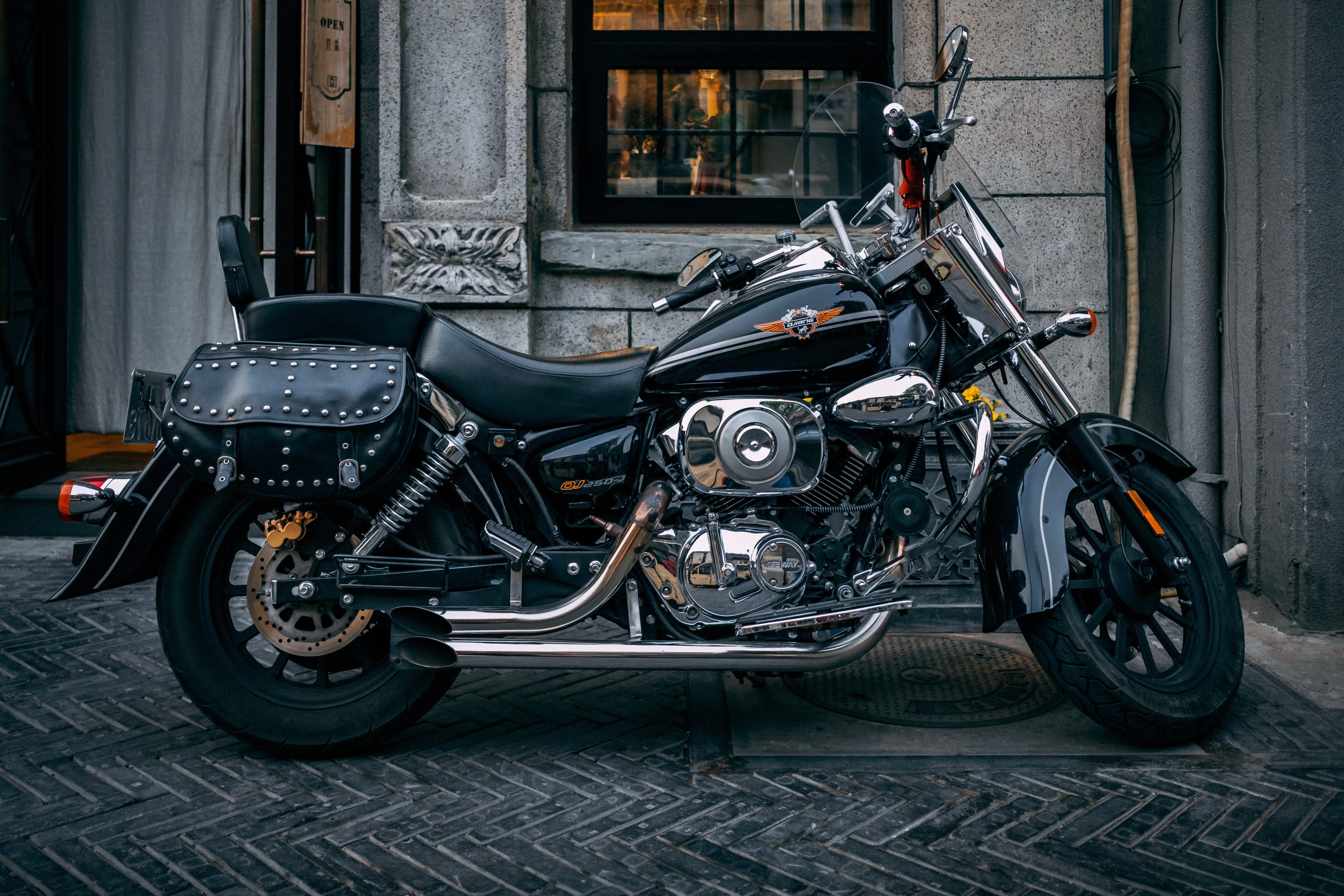 black and gray touring motorcycle parked near window