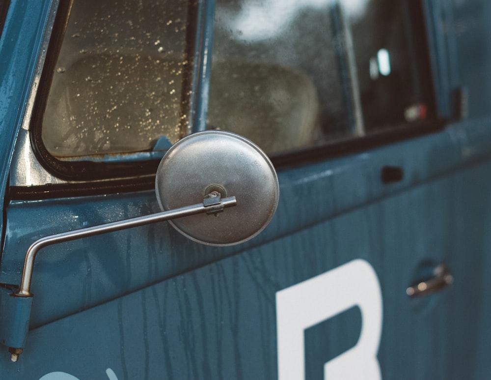 gray vehicle side mirror in closeup shot