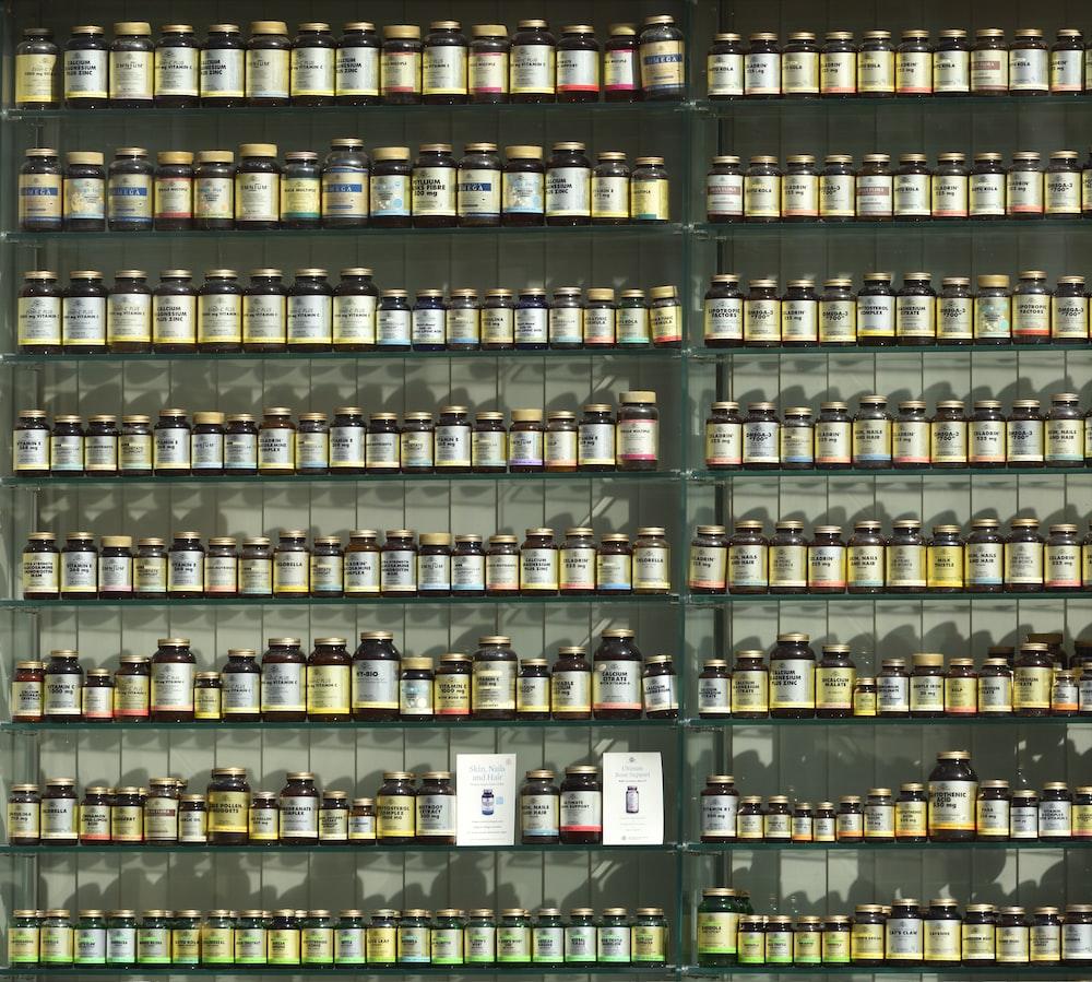 assorted labeled bottle on display shelf