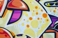 yellow, purple, and orange wall graffiti