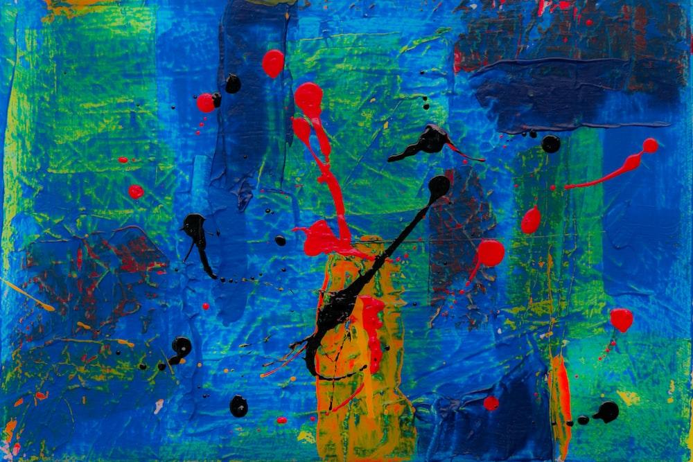 green, blue, and orange paint splat artwork