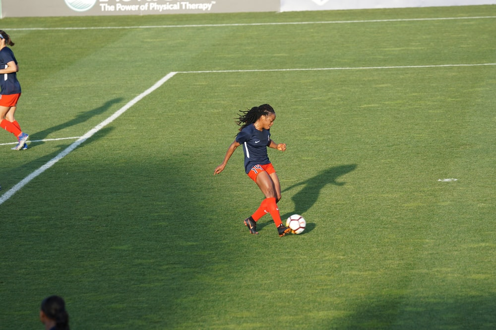 woman playing soccer at daytime
