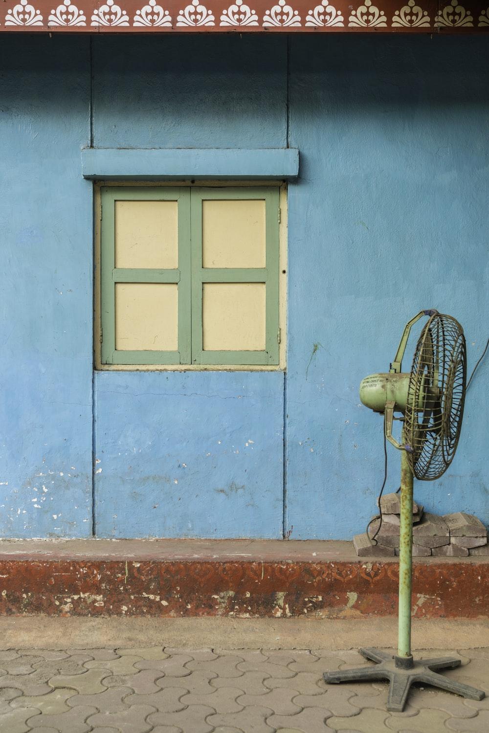 brown pedestal fan