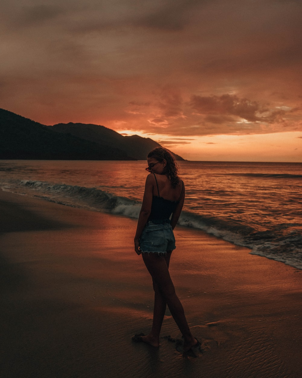 woman standing on sea shore