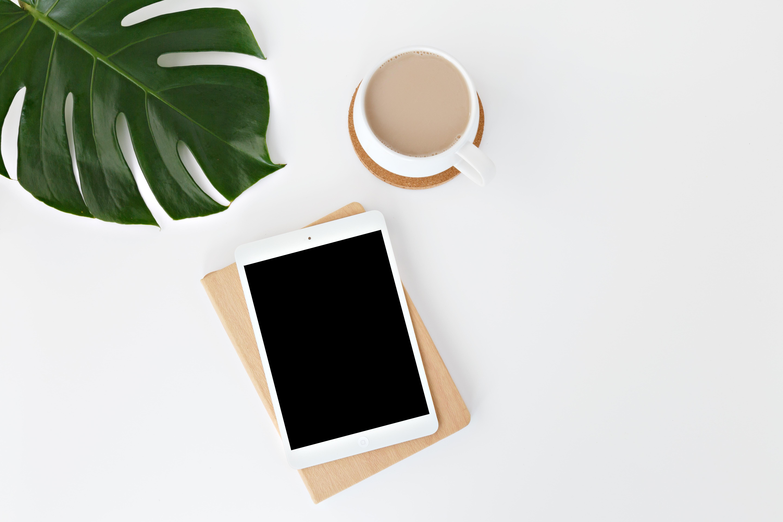 white iPad on white surface