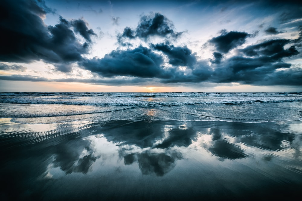 photo of seawaters and gray clouds