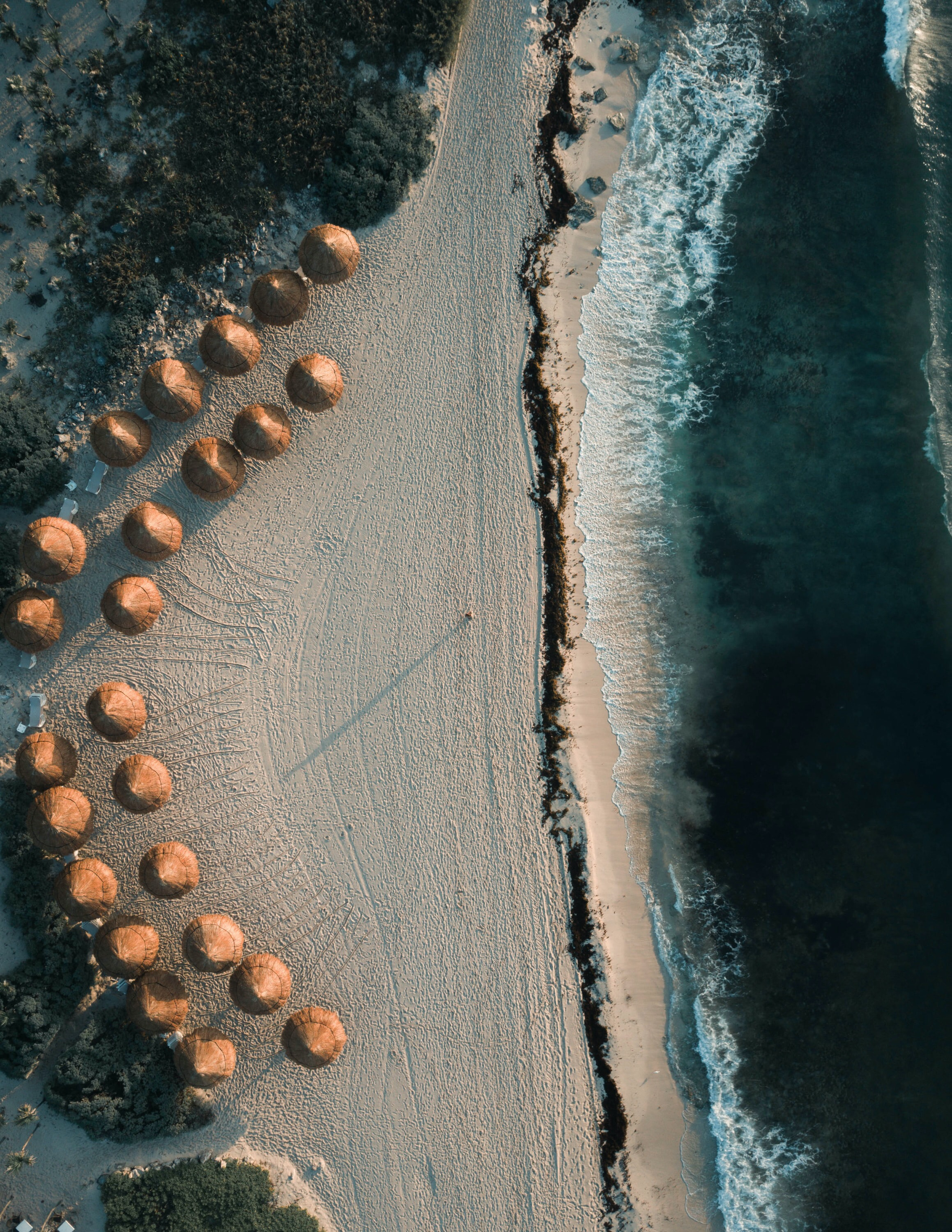aerial photography of brown cottages on seashore at daytime