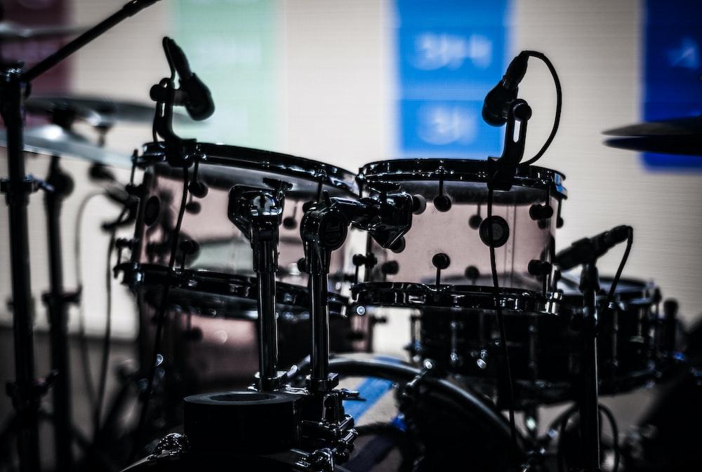 black drum set shallow focus photography