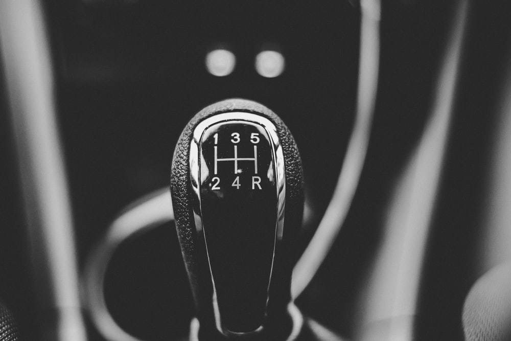 focus photography of car shift gear