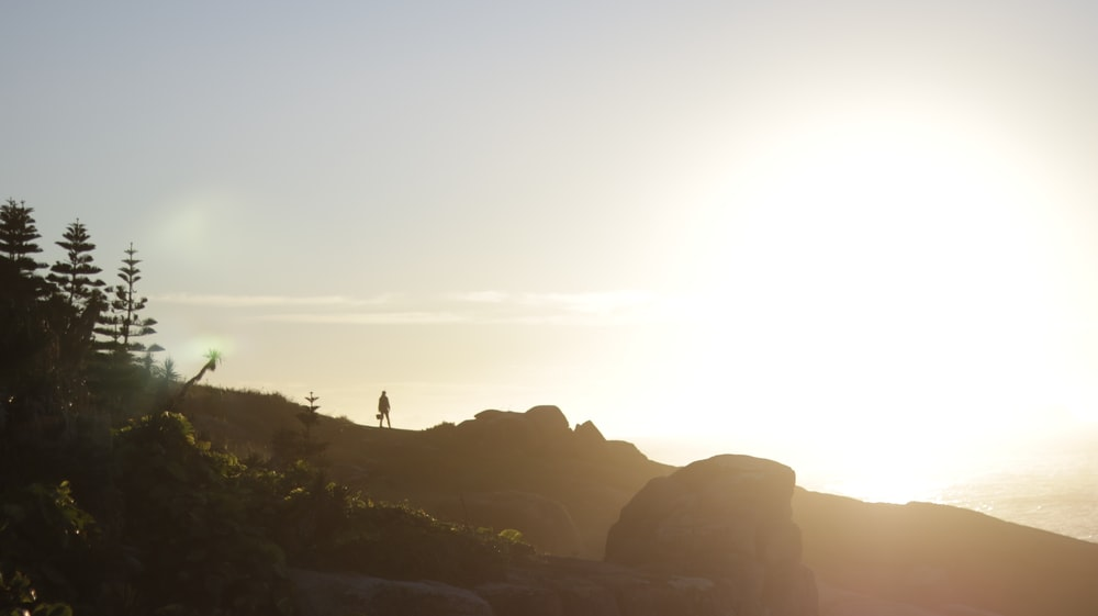 silhouette of person on mountain