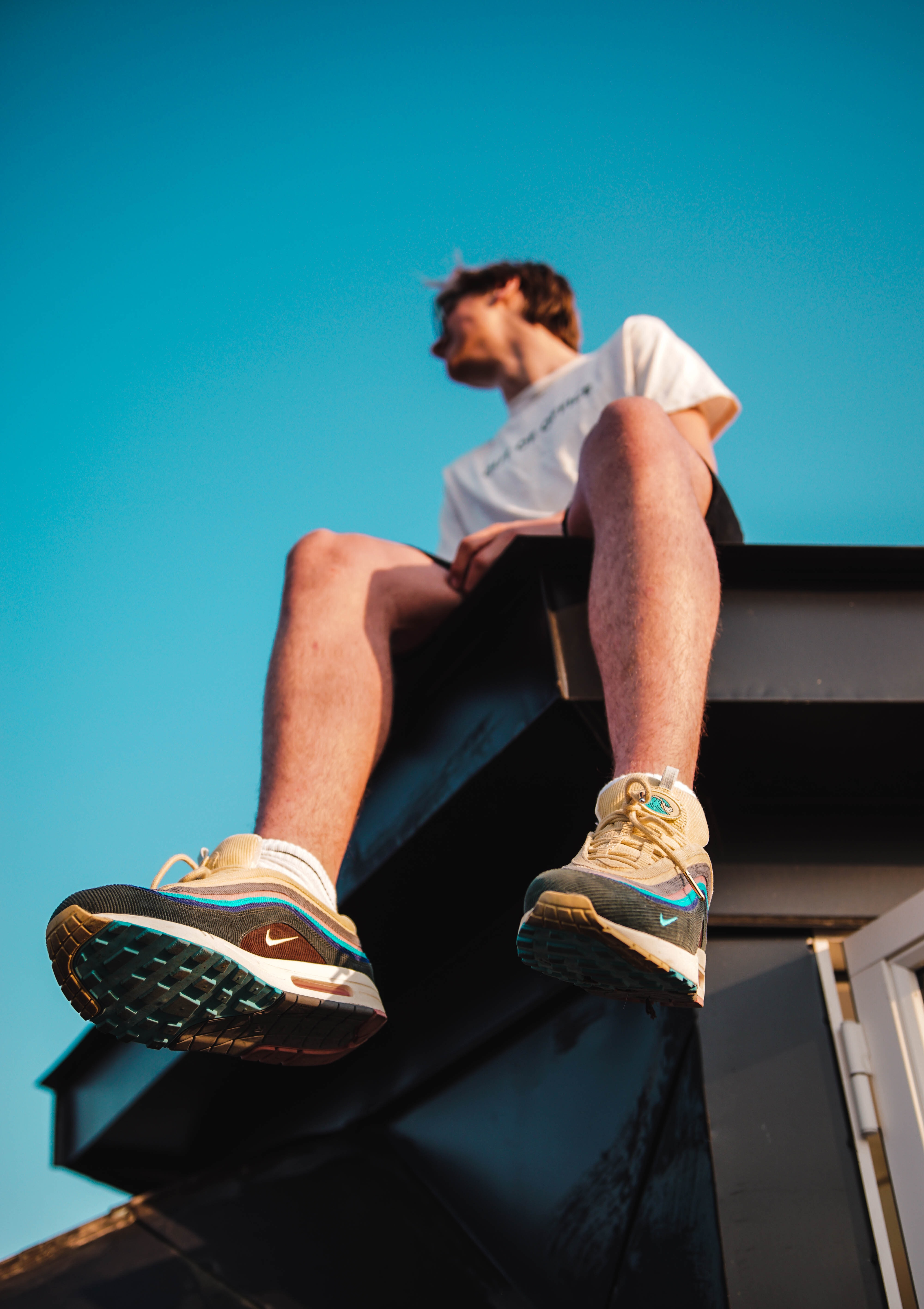 person sitting on top of a roof