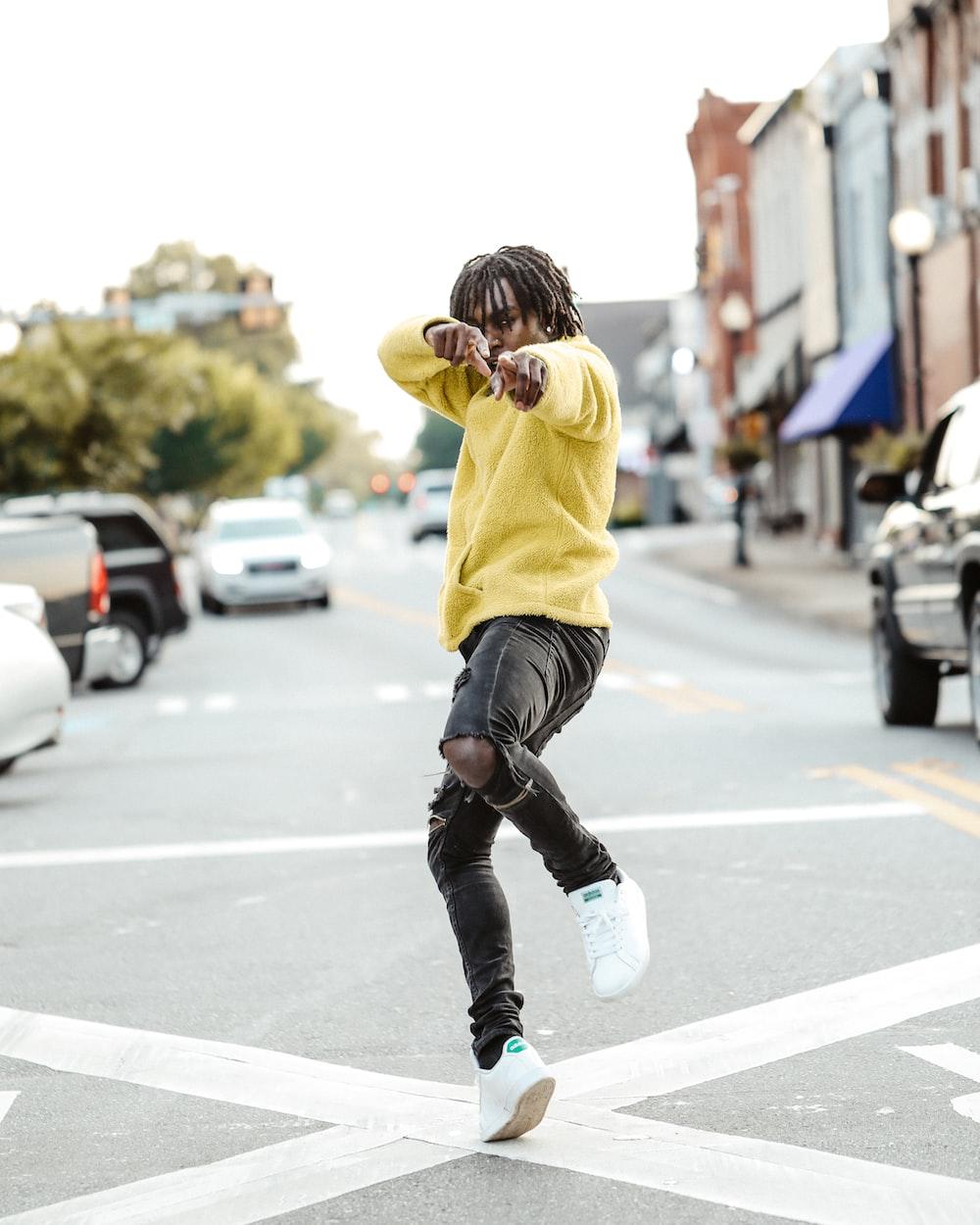 man standing on street at daytime