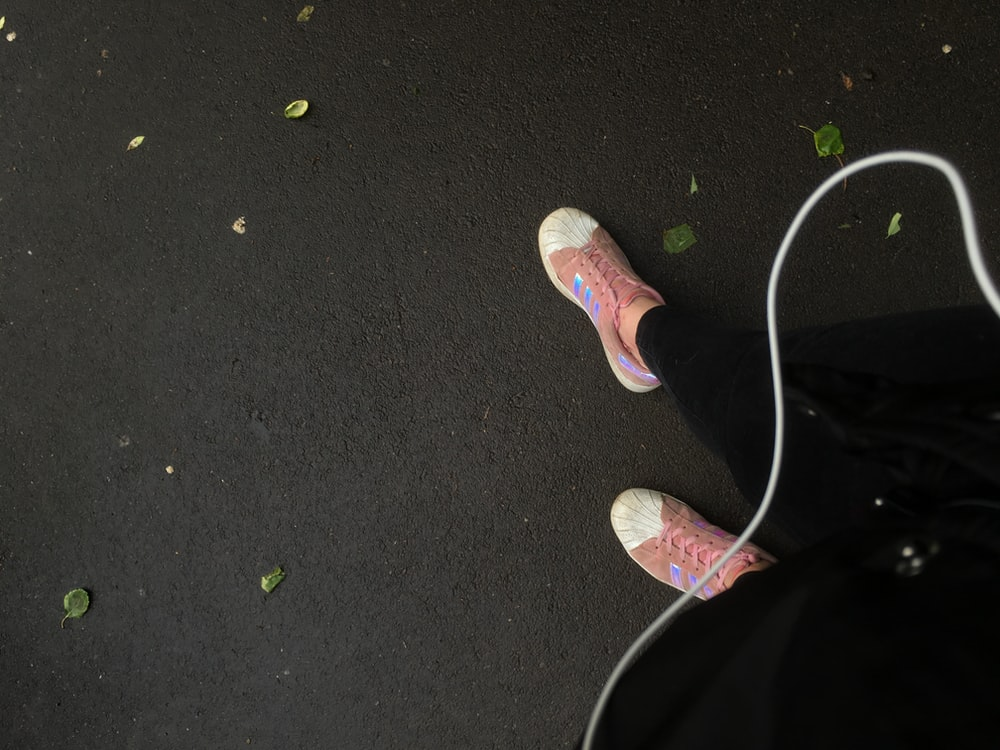 person wearing pink sneakers