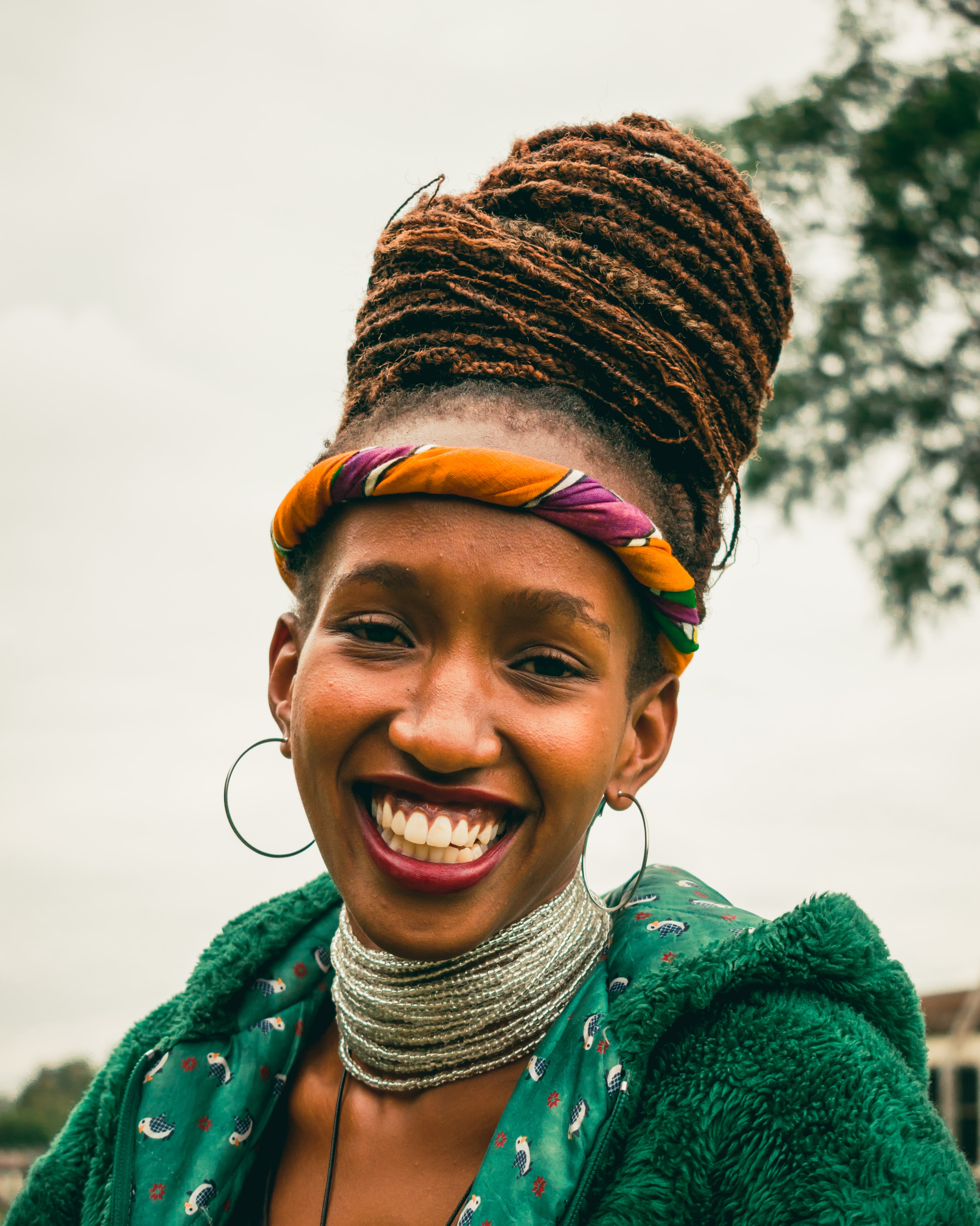 smiling woman with dreadlocks