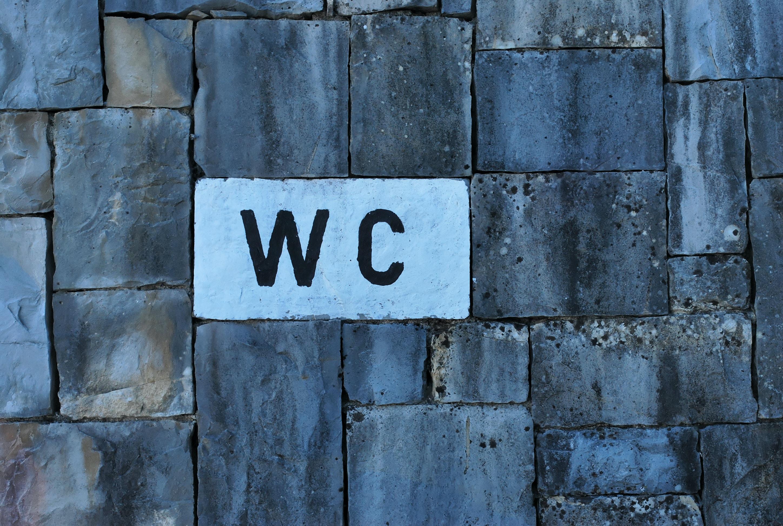 WC text on white brick
