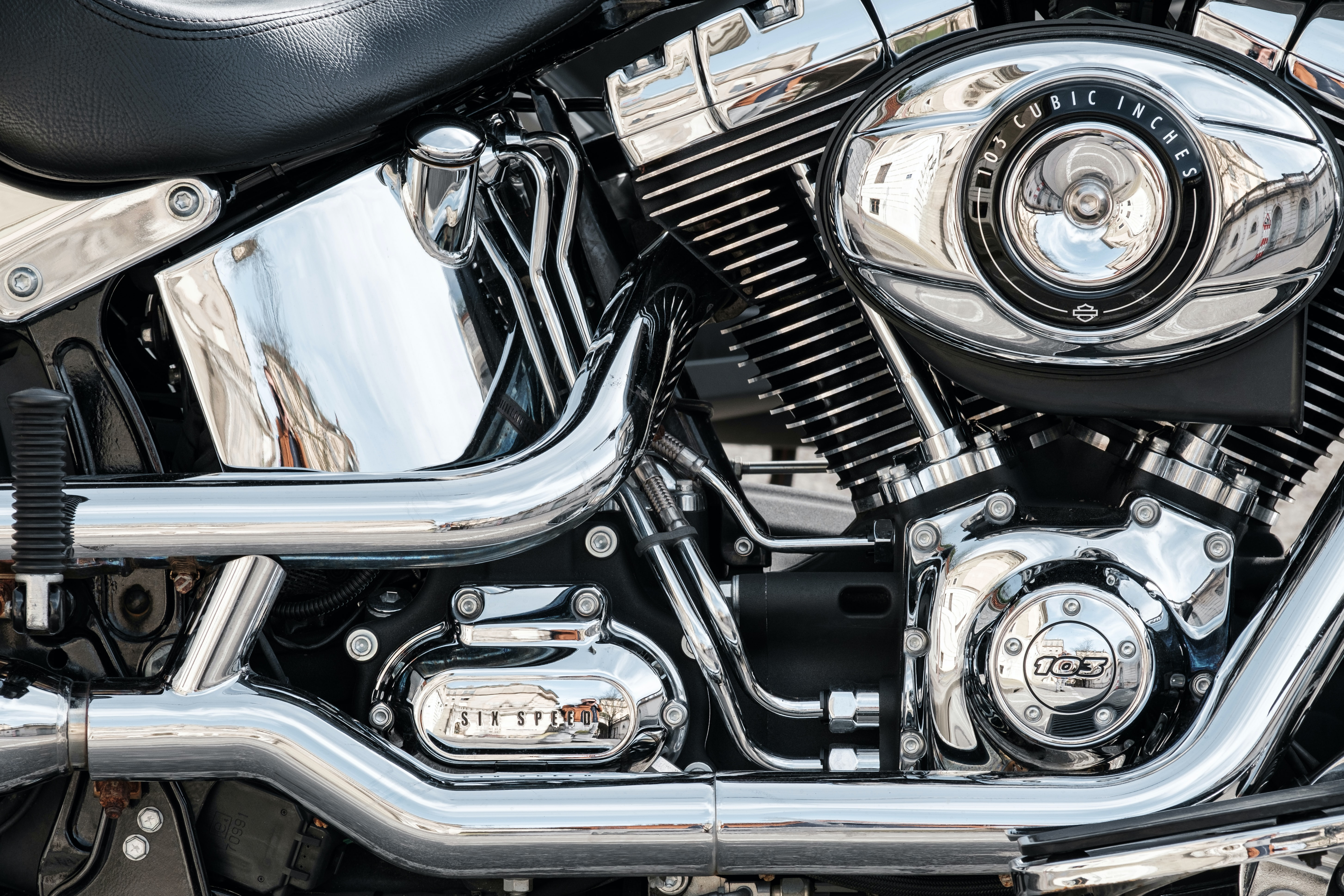 shallow focus photography of gray motorcycle engine