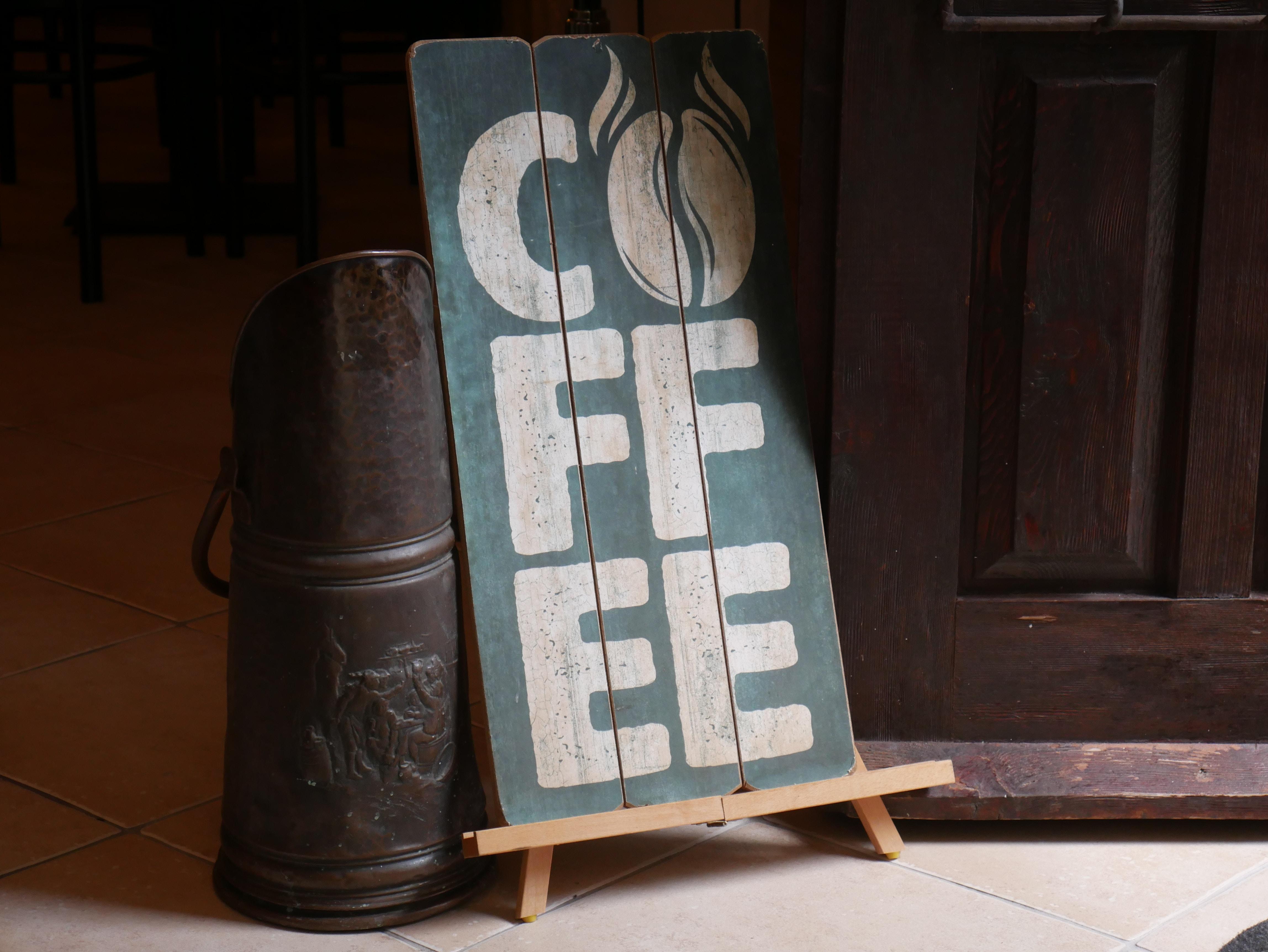 Coffee signboard near door