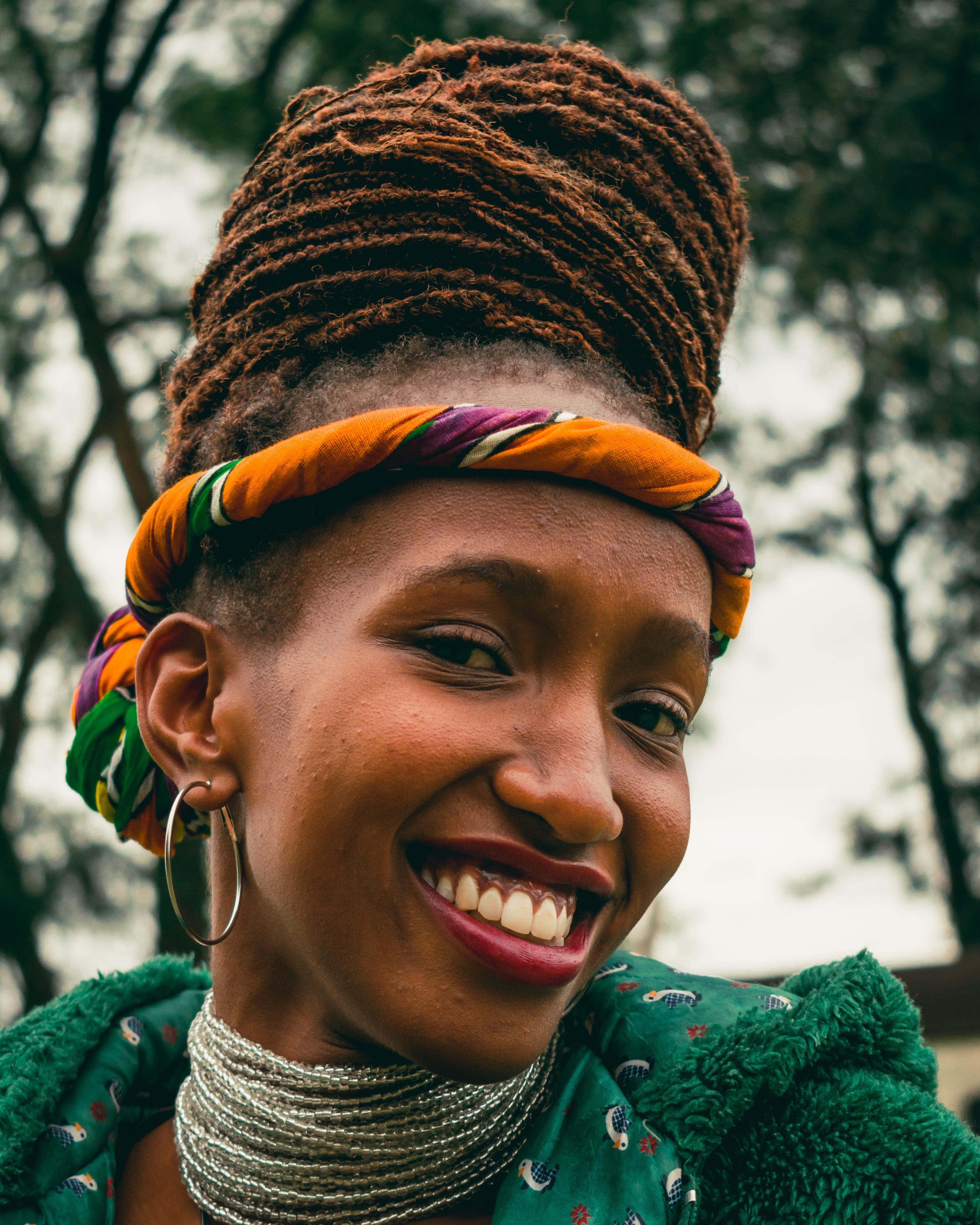 smiling woman wearing multi-strand choker