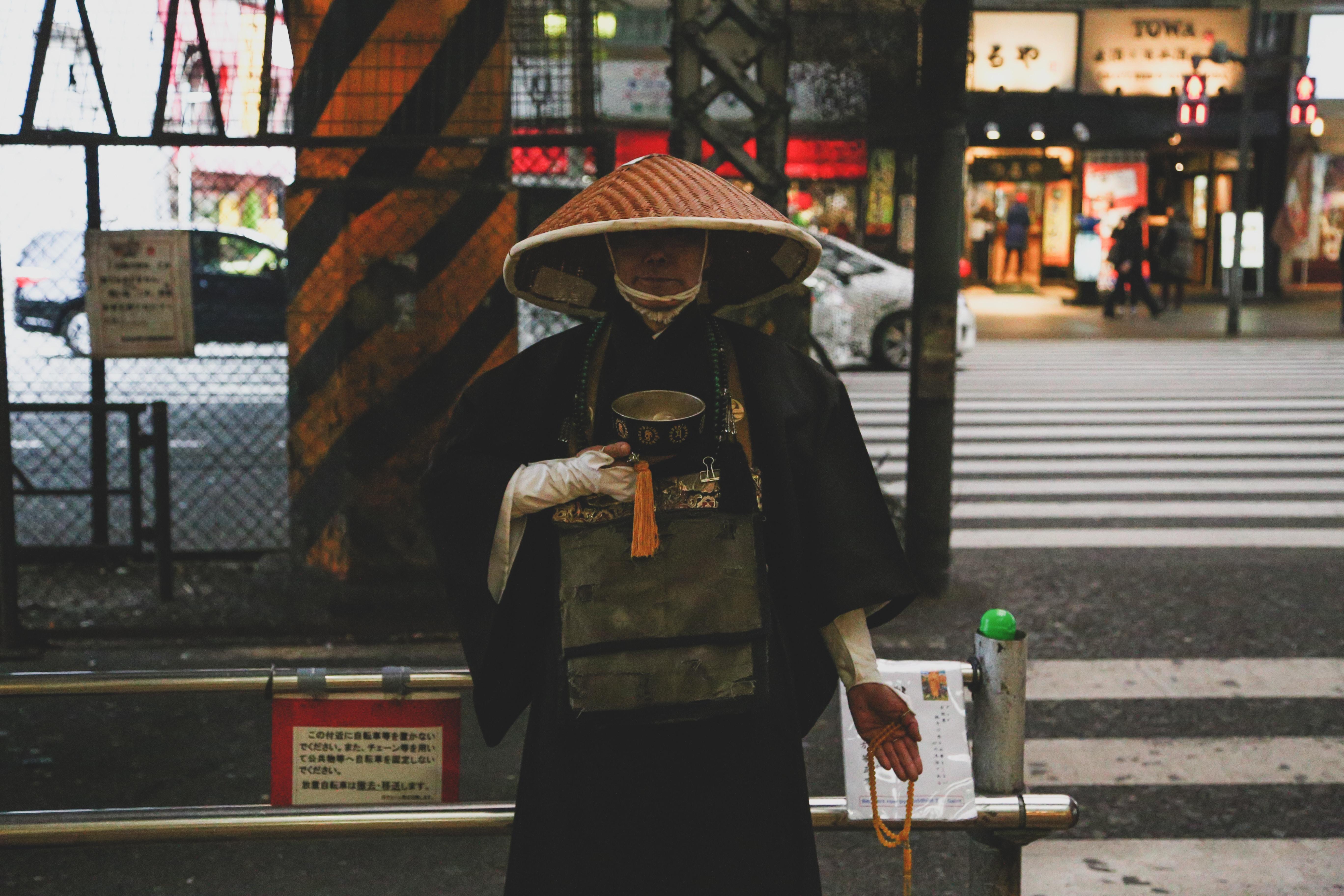 Chinese man walking on road