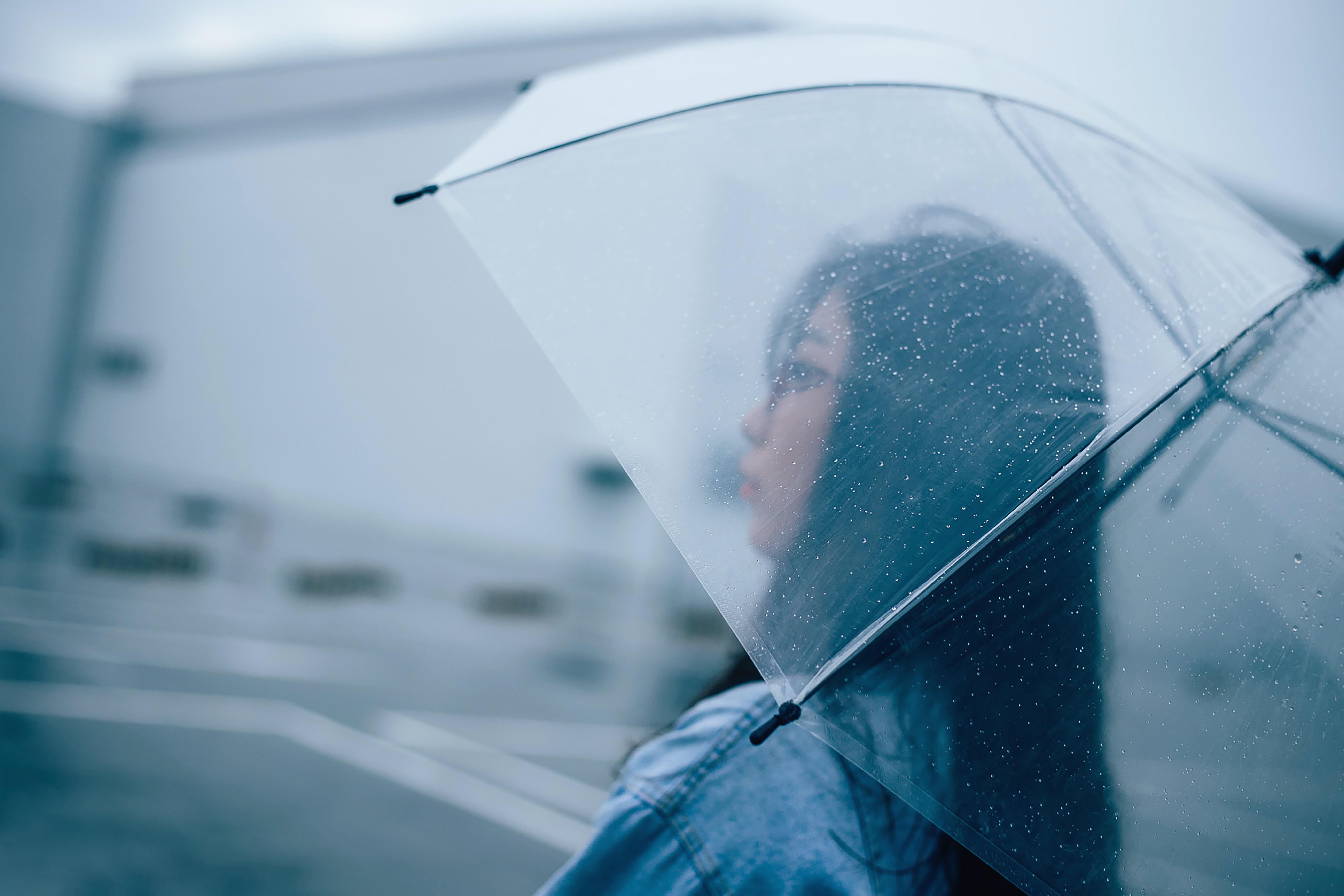 macro shot photography of woman holding umbrella