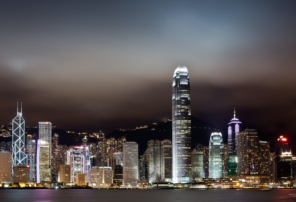 landscape photo of city buildings during night