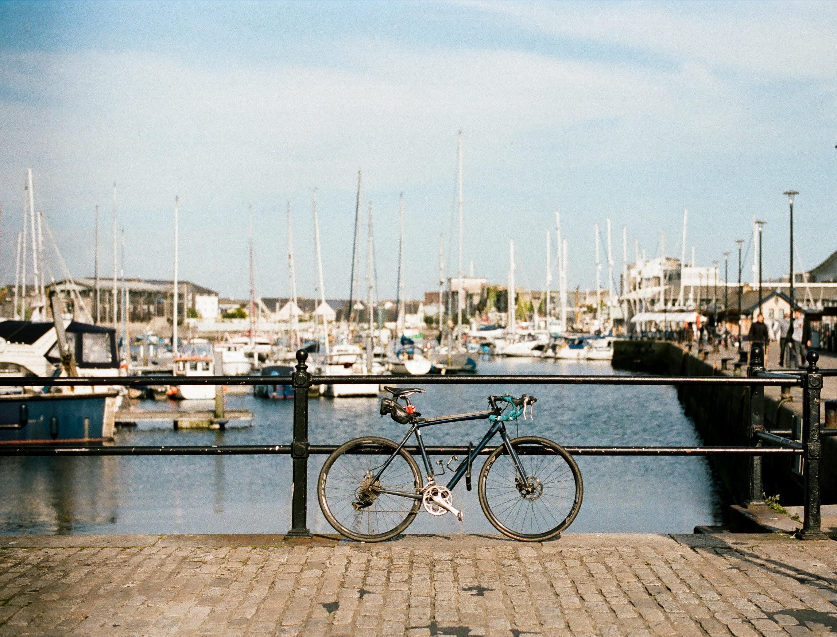black bike parked near black railings