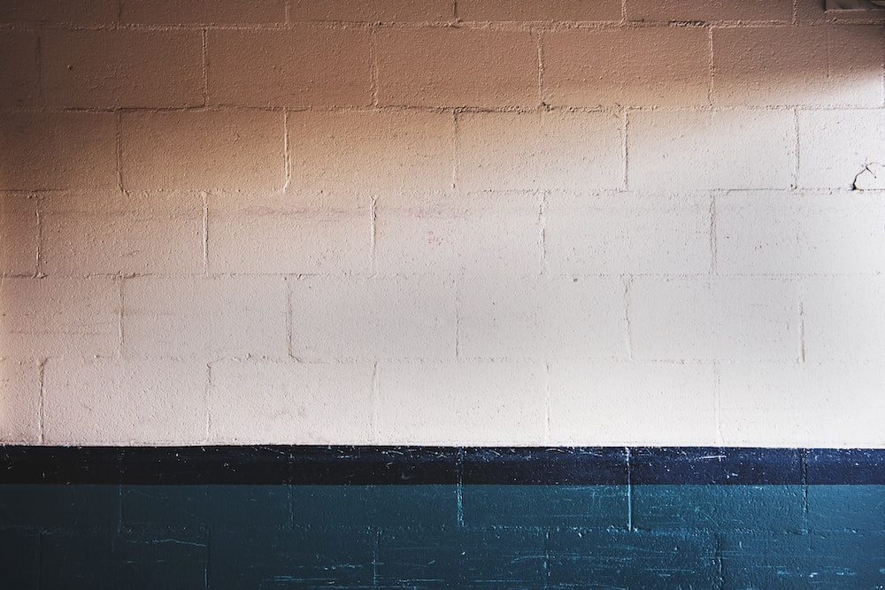 white and teal brick wall