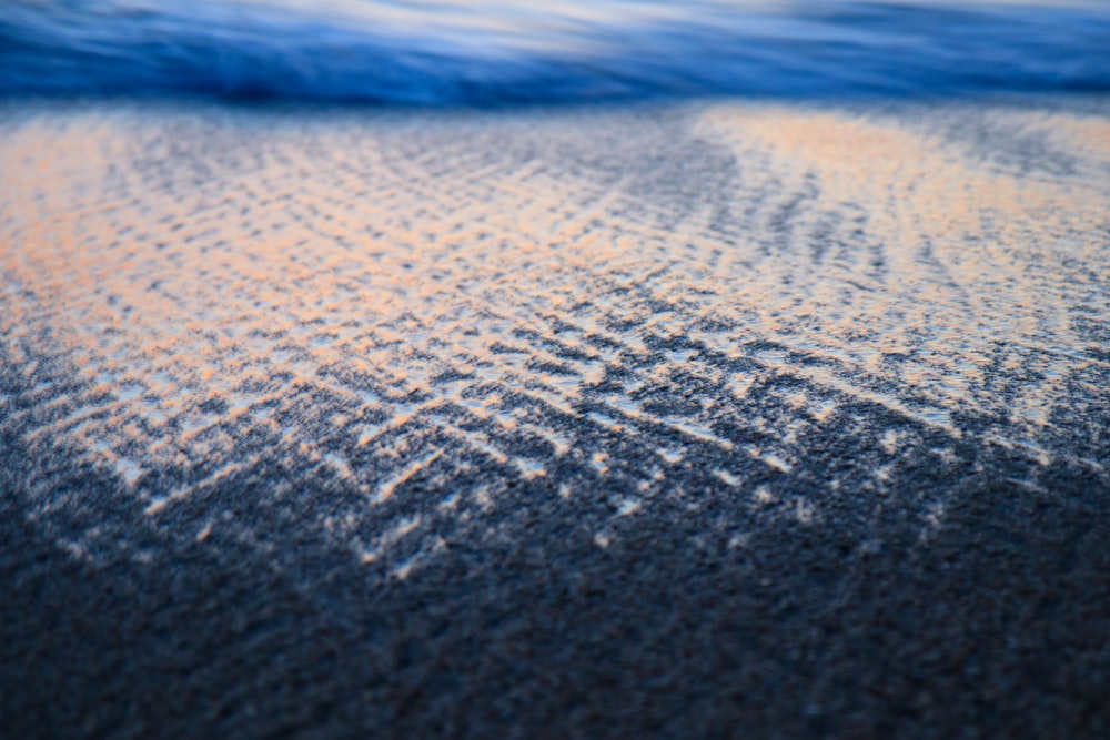 closeup photo of gray area rug
