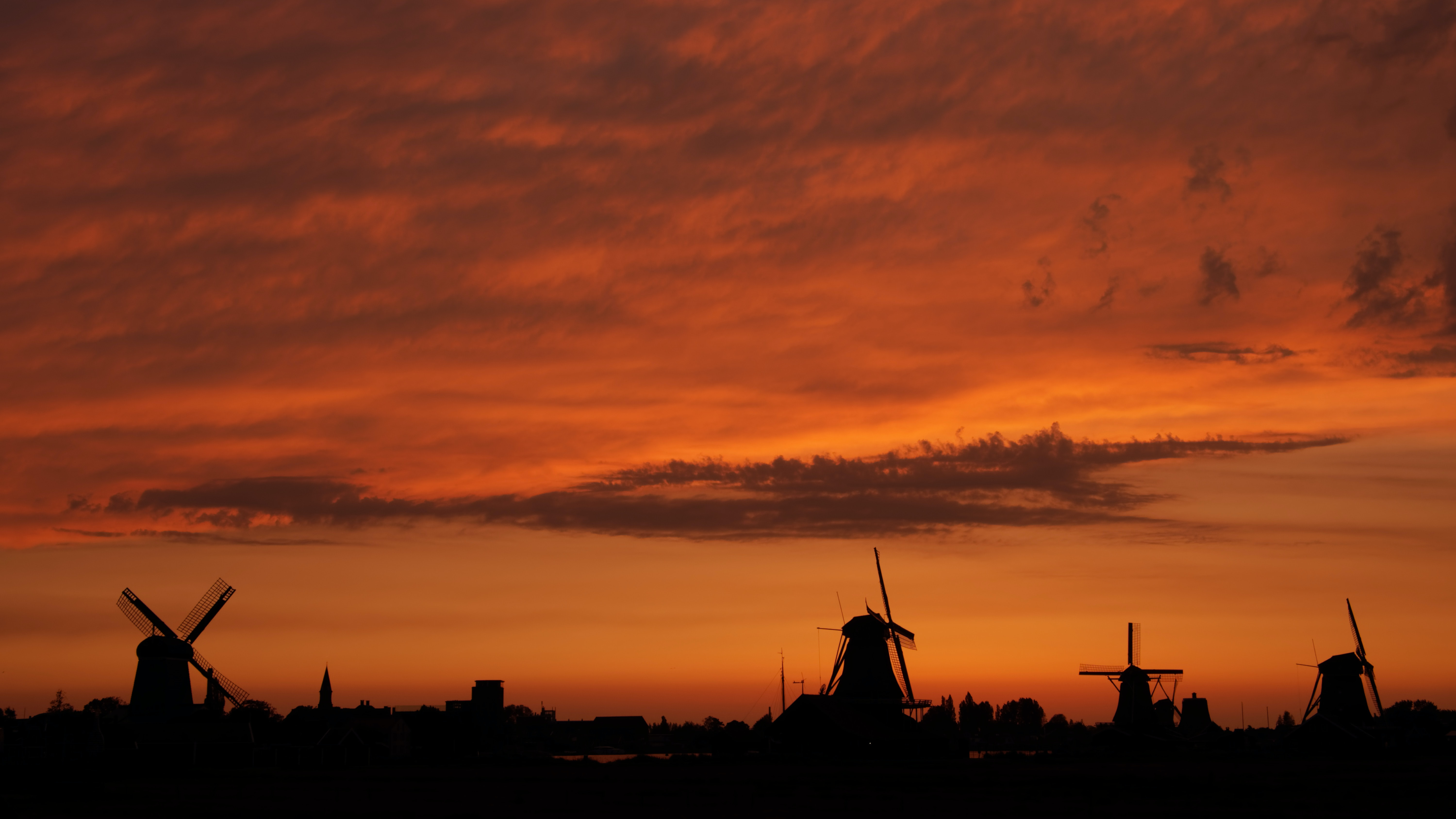 windmill silhouette during golden house