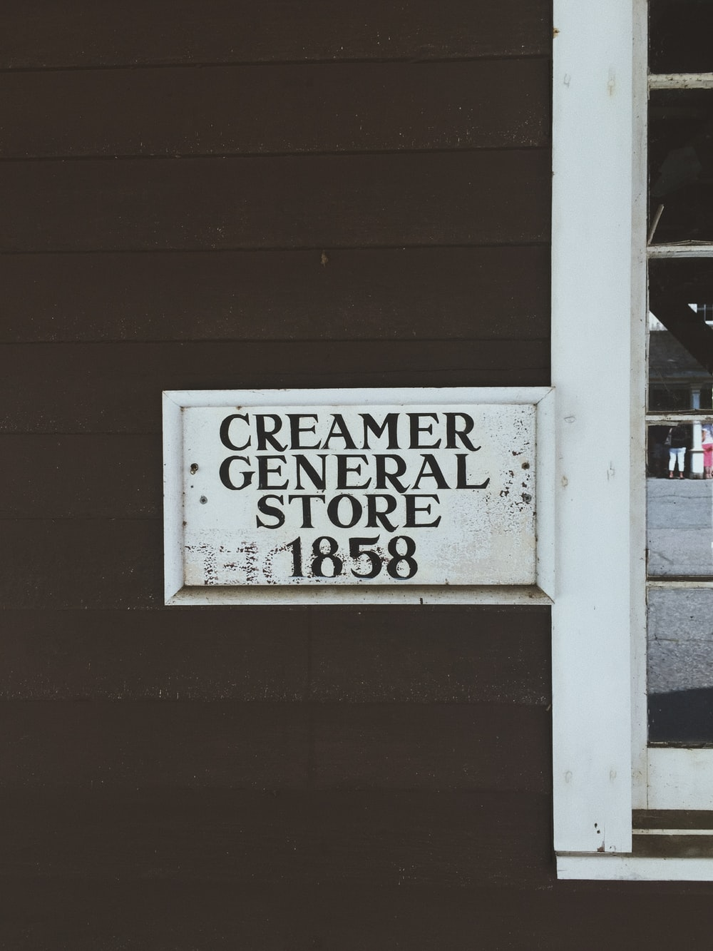 1858 Creamer General Store signage on wooden wall
