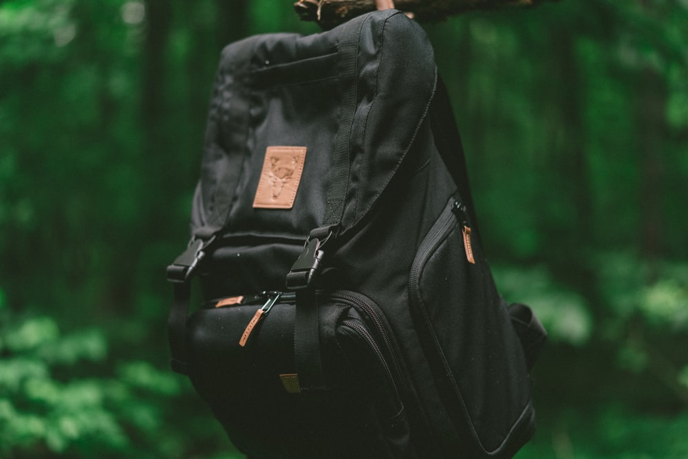 hanging black and brown backpack