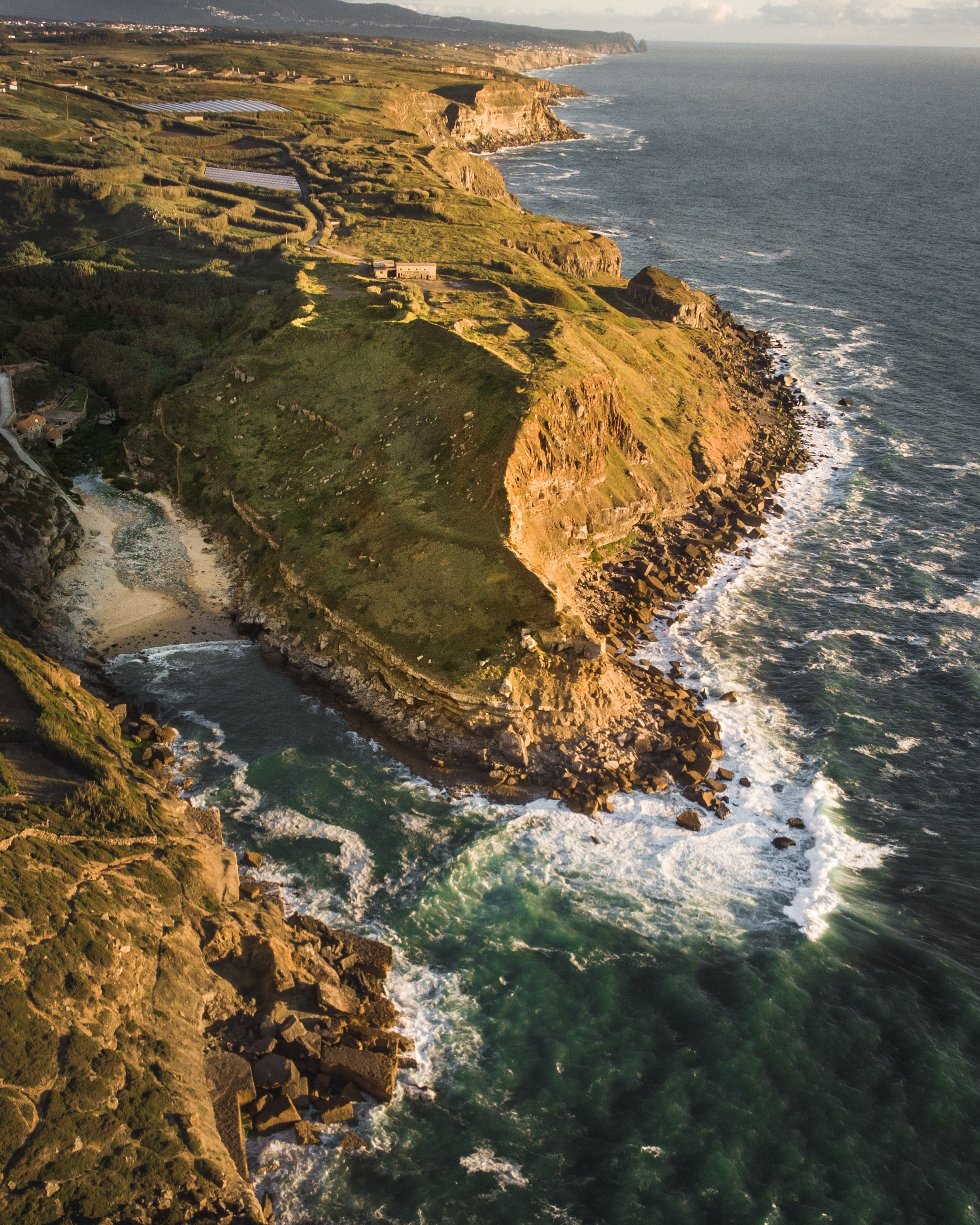 aerial photography of mountain by the seashore