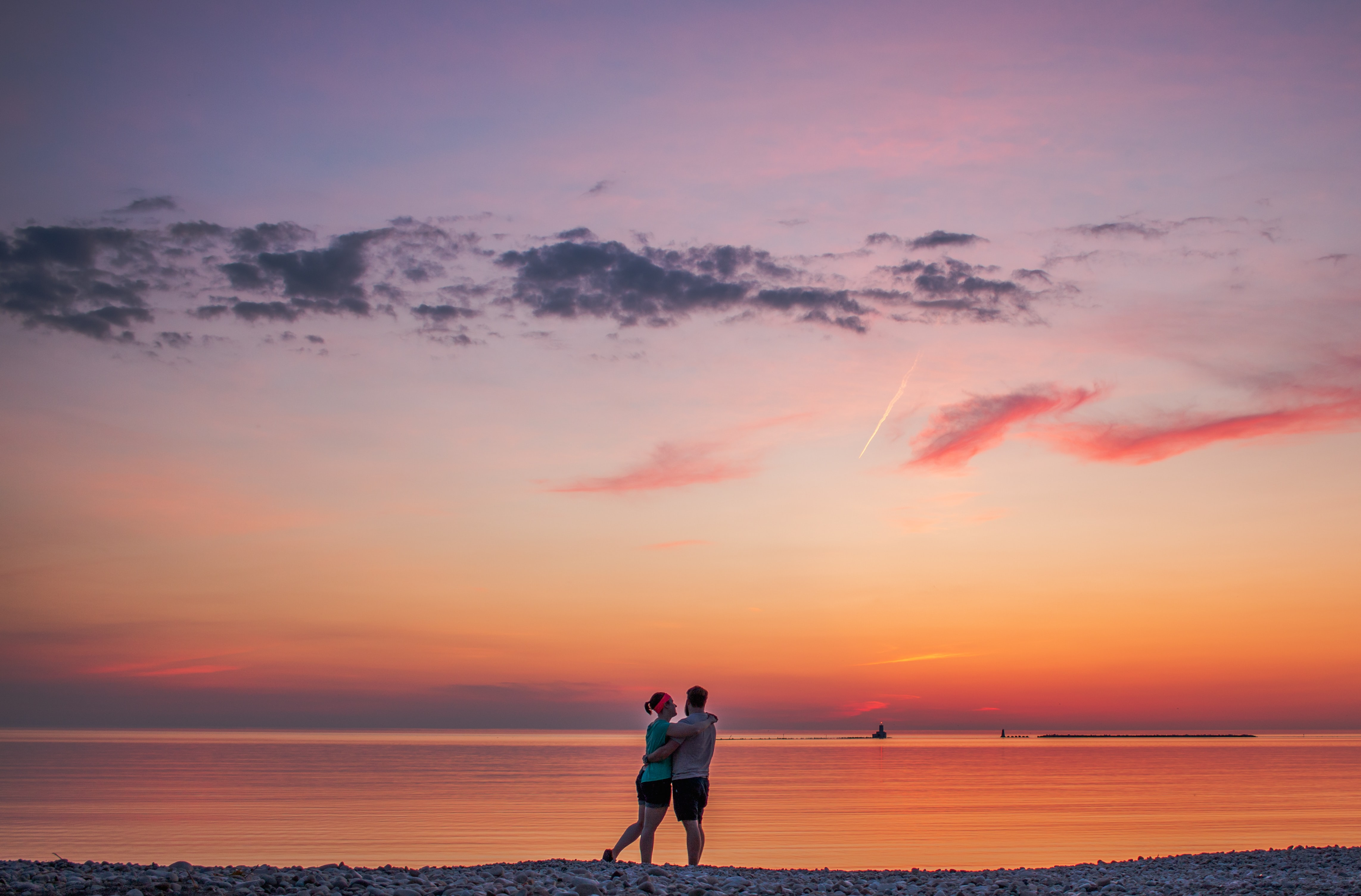 couple hugging each other near seashore