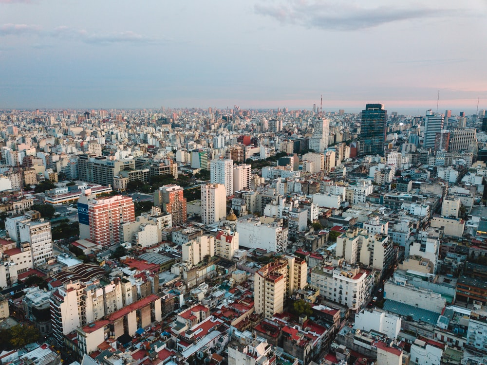 aerial view of city under cloudy sky during daytime