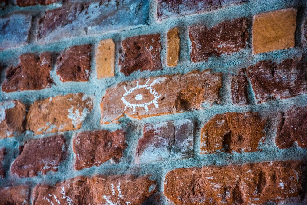 photo of brown concrete brick wall