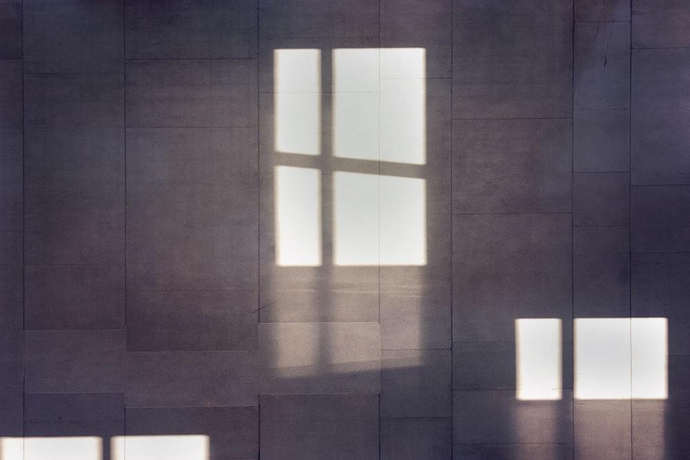 three sunlight rays on gray surface